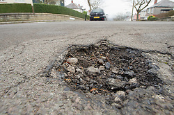 Potholes in the road can be a hazard for motorists and cyclists, Greystones Road, Sheffield