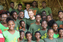 Prince Harry poses with volunteers during a visit to 'Nature Fun Ranch', which allows young people to speak freely with one another about important topics, including HIV/AIDS, providing them with a positive focus to guide their lives in the right direction, during his tour of the Caribbean.