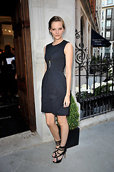 SARA BLOMQVIST at the opening party for Nicholas Kirkwood's new store at 5 Mount Street, London on 12th May 2011.