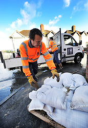© Licensed to London News Pictures. Date 9 Jan 2014. Oxford. Council worker deliver the sand bags. River Thames floods at Oxford causing the closure of the Abingdon and Botley roads.. Photo credit : MarkHemsworth/LNP