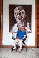 """Barranco, resident arrtists.  The famous painter Victor Delfin portrait with one of his works in his """"casa-taller"""""""