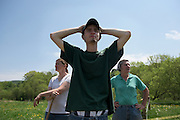 Matt Deome, with his mother Amy at left, and Joan Wortman at right, looks over the Green Acres pasture land and up to the barn after setting the cows to graze in South Randolph, Vt., Wednesday, May 25, 2016. Though he has been unable to secure a loan for the farm's purchase, Wortman is leasing him the farm for up to a year until he can get financing.  (Valley News - James M. Patterson) Copyright Valley News. May not be reprinted or used online without permission. Send requests to permission@vnews.com.