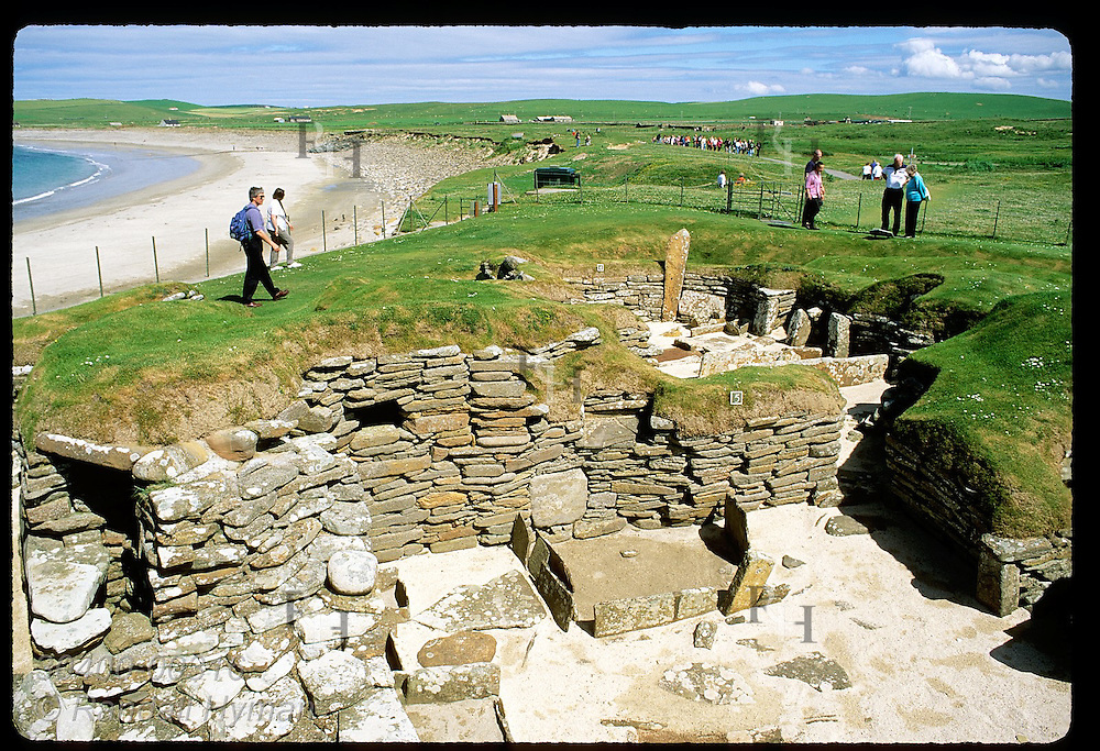 Ruins of Skara Brae, found in wake of sandstorm in 1850, lie open to view after 5000 yrs; Orkney. Scotland
