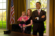 Standing with a mother and child and in a recreation of the Oval Office, the waxwork figure of the 44th President of the United States, Barack Obama stands in London's Madame Tussauds waxwork museum on the day of his inauguration. Long before the actual election took place, models of both Obama and political opponent, John McCain were researched from thousands of photographs and 500 body measurements and prepared from clay, taking 20 dedicated sculptors 4 months to prepare. Only the eventual victor was completed using wax and real organic hair. On Obama's inauguration day, US citizens were allowed free entry to the museum which is now Britain's most visited tourist attraction.