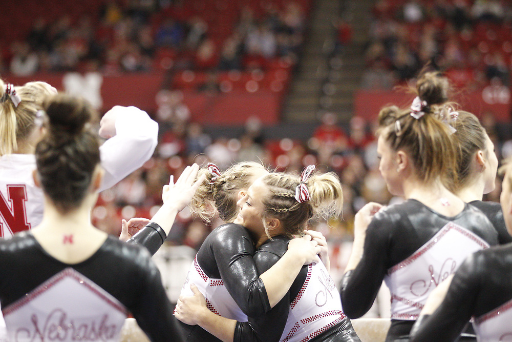 Grace Williams is congratulated by her teammates after competing on the beam at the Bob Devaney Sports Center in Lincoln, Neb., on Feb. 12, 2016. Photo by Aaron Babcock, Hail Varsity