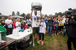 © Licensed to London News Pictures. 08/04/2018. Dorking, UK. Winners of the race CHRIS HEPWOTH AND TANISHA PRINCE  are presented with a barrel of beer. Competitors take part in the 2018 annual Wife Carrying Race in Dorking, Surrey. The race, which is run over a course of 380m, with both men and women carry a 'wife' over obstacles, is believed to have originated in the UK over twelve centuries ago when Viking raiders rampaged into the northeast coast of England carrying off any unwilling local women . Photo credit: Ben Cawthra/LNP
