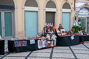 Pedestrian street of Rua Visconde da Luz in Coimbra, Portugal with an arts and crafts fair