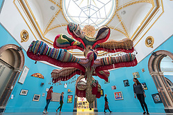 "© Licensed to London News Pictures. 05/06/2018. LONDON, UK. Staff members view ""Royal Valkyrie"" by Joana Vasconcelos at a preview of the 250th Summer Exhibition at the Royal Academy of Arts in Piccadilly, which has been co-ordinated by Grayson Perry RA this year.  Running concurrently, is The Great Spectacle, featuring highlights from the past 250 years.  Both shows run 12 June to 19 August 2018.  Photo credit: Stephen Chung/LNP"