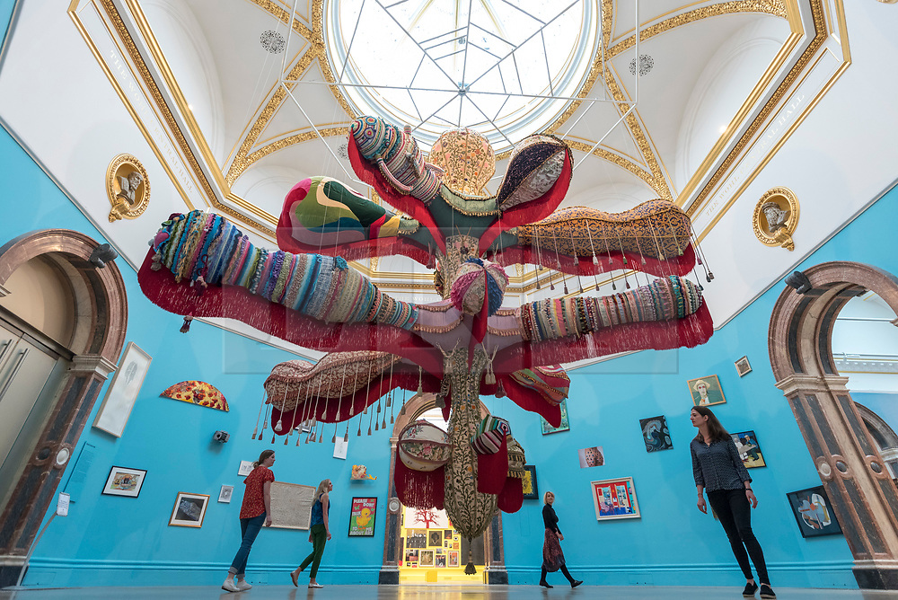 """© Licensed to London News Pictures. 05/06/2018. LONDON, UK. Staff members view """"Royal Valkyrie"""" by Joana Vasconcelos at a preview of the 250th Summer Exhibition at the Royal Academy of Arts in Piccadilly, which has been co-ordinated by Grayson Perry RA this year.  Running concurrently, is The Great Spectacle, featuring highlights from the past 250 years.  Both shows run 12 June to 19 August 2018.  Photo credit: Stephen Chung/LNP"""