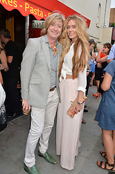 NICKY CLARKE and KELLY SIMPKIN at a party to celebrate the 30th Anniversary of Chelsea Bun, Limerston Street, London SW10 on 2nd July 2014.