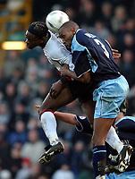 Photo. Javier Garcia<br />16/02/2003 Fulham v Burnley, FA Cup 5th Round, Loftus Road<br />Burnley's Drissa Diallo keeps Louis Saha out