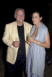 MR & MRS DAVE GILMOUR, he is the musician at a<br />  party in London on 9th May 2000.ODS 45