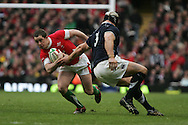 Shane Williams of Wales goes past Scotland's Euan Murray. RBS Six nations, Wales v Scotland at the Millennium stadium, Cardiff on Sat 13th Feb 2010. pic by  Andrew Orchard sports photography,