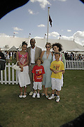 Mr. and Mrs. Colin Salmon, Sasha, ( pink) Rudi, Benjamin ( youngest) and Eden. Cartier International Polo. Guards Polo Club. Windsor Great Park. 30 July 2006. ONE TIME USE ONLY - DO NOT ARCHIVE  © Copyright Photograph by Dafydd Jones 66 Stockwell Park Rd. London SW9 0DA Tel 020 7733 0108 www.dafjones.com