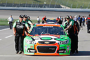 Danica Patrick's pit crew pushes her car along pit row before the start of qualifying for a NASCAR Sprint Cup series auto race, Friday, May 9, 2014, at Kansas Speedway in Kansas City, Kan. (AP Photo/Colin E. Braley)