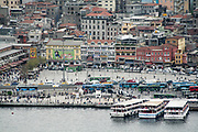 Istanbul, Turky as seen from the Bosphorus. with boats in the foreground
