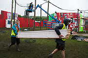 Art work going up at Shangri-la at the Glastonbury Festival 19th July 2016, Somerset, United Kingdom. Shangri-la is a venue at the festival with  art and politics mixed with tunes and all night club nights. Work getting the festival ready takes weeks and in the days up to the festival starts work is frantic.  The Glastonbury Festival runs over 3 days and has 3000 acts, including music, art and performance and approx. 150.000 attend the anual event.