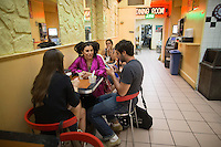 The seating area at Taste of Persia, a small and unique food stall inside another restaurant called Pizza Paradise in New York.<br /> <br /> (Photo by Robert Caplin)
