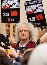 "Westminster, London, July 14th 2015. Hundreds of animal rights activists and members of hunt saboteur groups gather outside Parliament to ""Fight For THe Fox"" as Paliament discusses an amendment to the bill outlawing fox hunting that could see the sport return to the British countryside. PICTURED: Queen guitarist and animal rights activist Brian May helps add influence to the anti-foxhunting campaign."