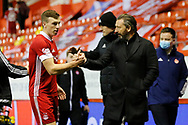 Aberdeen Manager Derek McInnes congratulates Aberdeen midfielder Lewis Ferguson (19) during the Scottish Premiership match between Aberdeen and Hamilton Academical FC at Pittodrie Stadium, Aberdeen, Scotland on 20 October 2020.