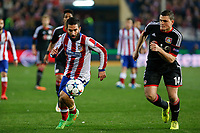 Atletico de Madrid´s Arda Turan (L) and Bayer 04 Leverkusen´s Papadopoulos during the UEFA Champions League round of 16 second leg match between Atletico de Madrid and Bayer 04 Leverkusen at Vicente Calderon stadium in Madrid, Spain. March 17, 2015. (ALTERPHOTOS/Victor Blanco)