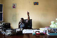 """CLIENT: THE GUARDIAN<br /> <br /> Chantal Rugenera Kambibi, head of mission for the Program of Stabilization and Reconstruction of Armed Conflict Zones (STAREC) in North Kivu, works from her office in Goma, D.R. Congo.  """"We who take courage, who talk, we're seen like women who lost their heads, who are abnormal,"""" says Kambibi."""