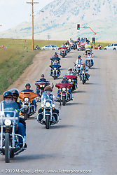 Military Tribute ride arriving at the Buffalo Chip's west gate during the annual Black Hills Motorcycle Rally. SD, USA. August 7, 2014.  Photography ©2014 Michael Lichter.