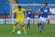 AFC Wimbledon midfielder Jake Reeves (8) and Peterborough United midfielder Chris Forrester (8) during the EFL Cup match between Peterborough United and AFC Wimbledon at ABAX Stadium, Peterborough, England on 9 August 2016. Photo by Stuart Butcher.