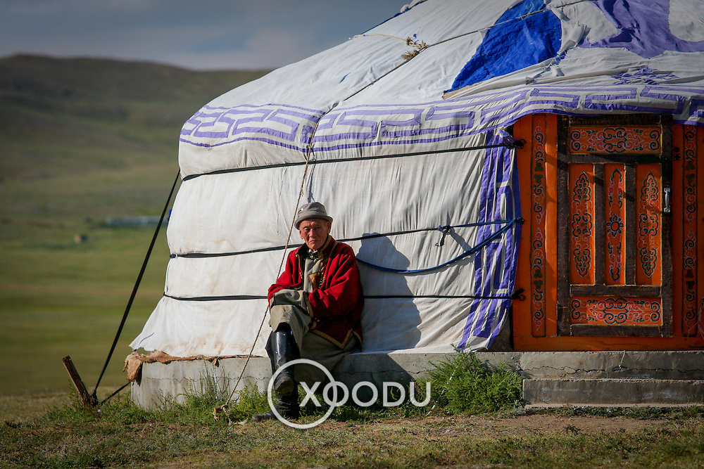 Old Mongolian man in traditional clothes by ger tent (, Mongolia - Aug. 2008) (Image ID: 080830-1148561a)