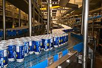 Conveyor belt of Corona beer cans, Modelo Brewery (brewing Corona Beer), Guadalajara, Mexico
