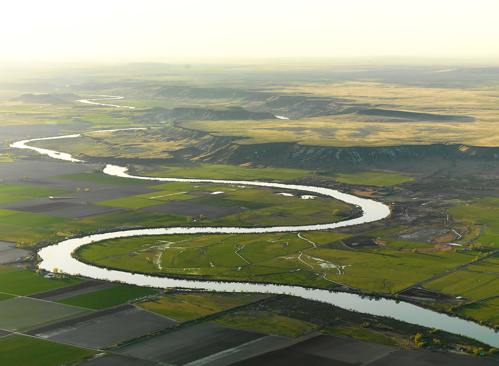 Open Edition Prints <br /> Snake River Oxbow near Grandview and south of Boise on a hazy summer evening just west of CJ Strike Reservoir in southern Idaho