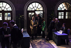 """© London News Pictures. """"Looking for Nigel"""". A body of work by photographer Mary Turner, studying UKIP leader Nigel Farage and his followers throughout the 2015 election campaign. PICTURE SHOWS - Nigel Farage arrives at the Emmanuel Centre in Westminster, London ahead of his major campaign speech on immigration on March 3rd 2015. Pictured to his right are (l-r)  Nigel's strategist Raheem Kassam, his personal assistant Lizzy Vaid, Immigration spokesperson Stephen Woolfe, Press officer Alex Phillips, and (seated) is junior press oficer John Gill. . Photo credit: Mary Turner/LNP **PLEASE CALL TO ARRANGE FEE** **More images available on request**"""