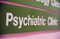 Close up of sign indicating direction of hospital Psychiatric Clinic,