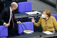 11 FEB 2021, BERLIN/GERMANY:<br /> Olaf Scholz (L), SPD, Bundesfinanzminister, und Angela Merkel (R), CDU, Bundeskanzlerin, im Gespraech, waehrend der Debatte nach Merkels Regierungserklaerung zur Bewaeltigung der Corvid-19-Pandemie, Plenum, Reichstagsgebaeude, Deutscher Bundestag<br /> IMAGE: 20210211-01-094<br /> KEYWORDS: Corona, Mundschutz, Maske, Gespräch
