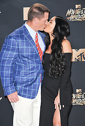 John Cena, Nikki Bella at the 2017 MTV Movie And TV Awards Press Room held at The Shrine Auditorium on May 7, 2017 in Los Angeles, California.<br /><br />(Photo by Sthanlee Mirador) *** Please Use Credit from Credit Field ***