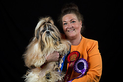 © Licensed to London News Pictures. 10/03/2016. Birmingham, UK. Sharon Galliford with her Shih Tzu named Hugo Boss at Crufts 2016 held at the NEC in Birmingham, West Midlands, UK. The world's largest dog show, Crufts is this year celebrating it's 125th anniversary. The annual event is organised and hosted by the Kennel Club and has been running since 1891. Photo credit : Ian Hinchliffe/LNP