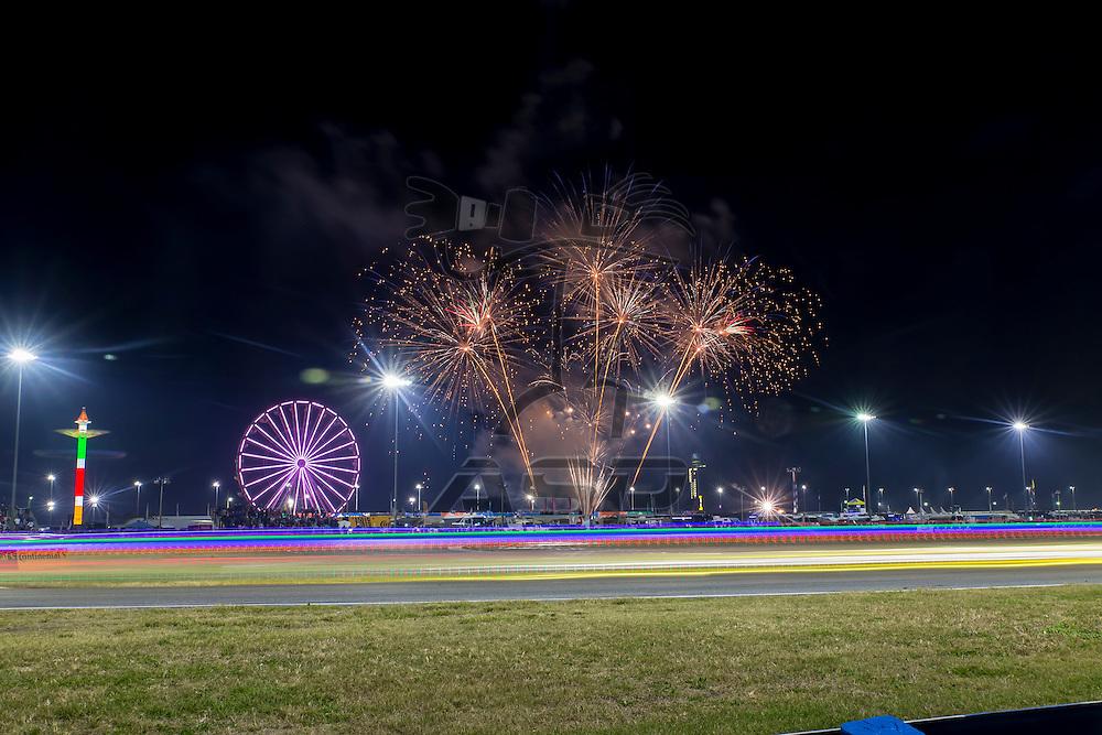 Daytona Beach, FL - Jan 30, 2016:  The IMSA WeatherTech Sportscar Championship teams take to the track as fireworks go off during the Rolex 24 at Daytona at Daytona International Speedway in Daytona Beach, FL.