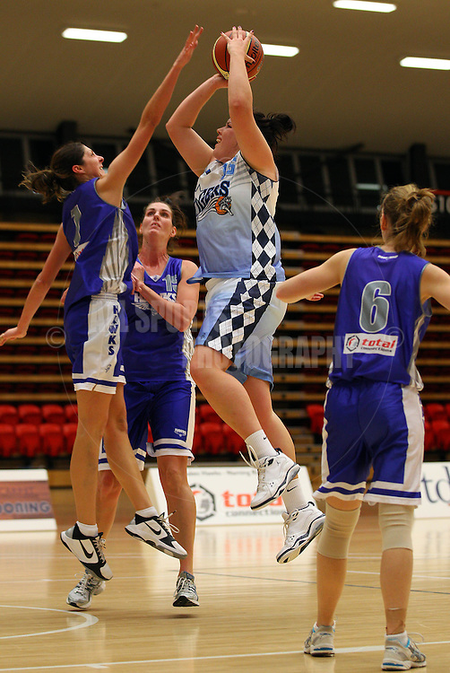 PERTH, AUSTRALIA - JULY 16: Zoe Harper of the of the Tigers lays up over Rosie Tobin of the Hawks during the week 18 SBL game between the Perry Lakes Hawks and the Willetton TIgers at The State Basketball Center on July 16, 2011 in Perth, Australia.  (Photo by Paul Kane/All Sports Photography)
