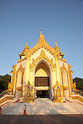 The entrance to the Shwedagon pagoda, the most sacred pagoda in the country, in the capital of Yangon (Rangoon), Myanmar