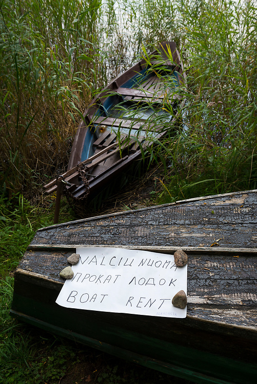 Trakai, Lithuania - August 8, 2015: A boat for rent rests on the shore of Lake Luka in Trakai, Lithuania. The town, best known for its picturesque red-brick castle, is located 28 kilometers from Vilnius.