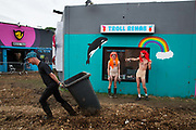 Harry Clayton-Wright and James Barnett as Trolls in front of the Troll Rehab centre, Shangri La field, Glastonbury Festival 2016. The Glastonbury Festival is the largest greenfield festival in the world, and is now attended by around 175,000 people. Its a five-day music festival that takes place near Pilton, Somerset, United Kingdom. In addition to contemporary music, the festival hosts dance, comedy, theatre, circus, cabaret, and other arts. Held at Worthy Farm in Pilton, leading pop and rock artists have headlined, alongside thousands of others appearing on smaller stages and performance areas.