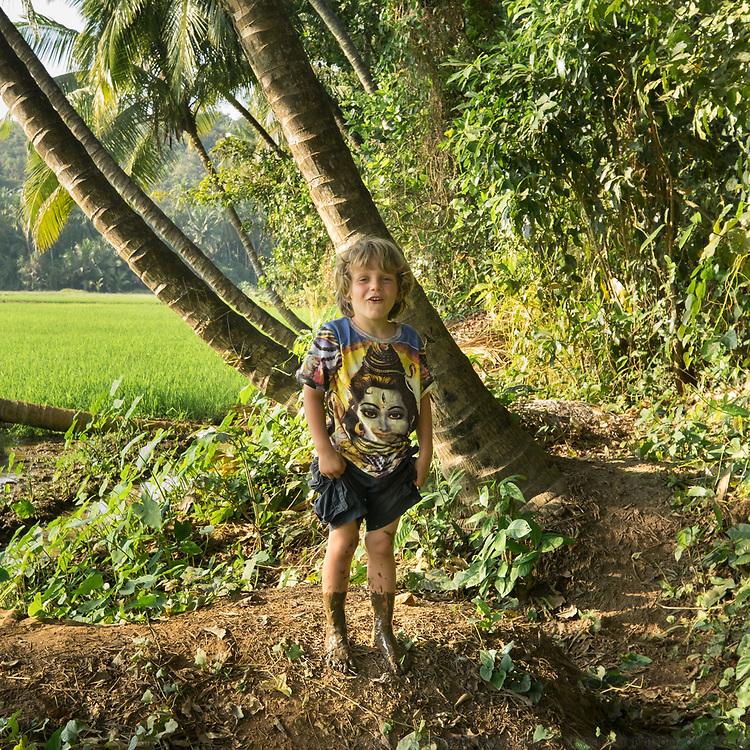 Boy looks upset because his feet are full of mud.
