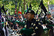 New York, NY - 10 September 2021. Official and private memorials are held at the 9/11 memorial site on the day before the 20th anniversary of the World Trade Center attacks. Members of the New York Police Department's Emerald Society Pipes and Drums lead a memorial service.