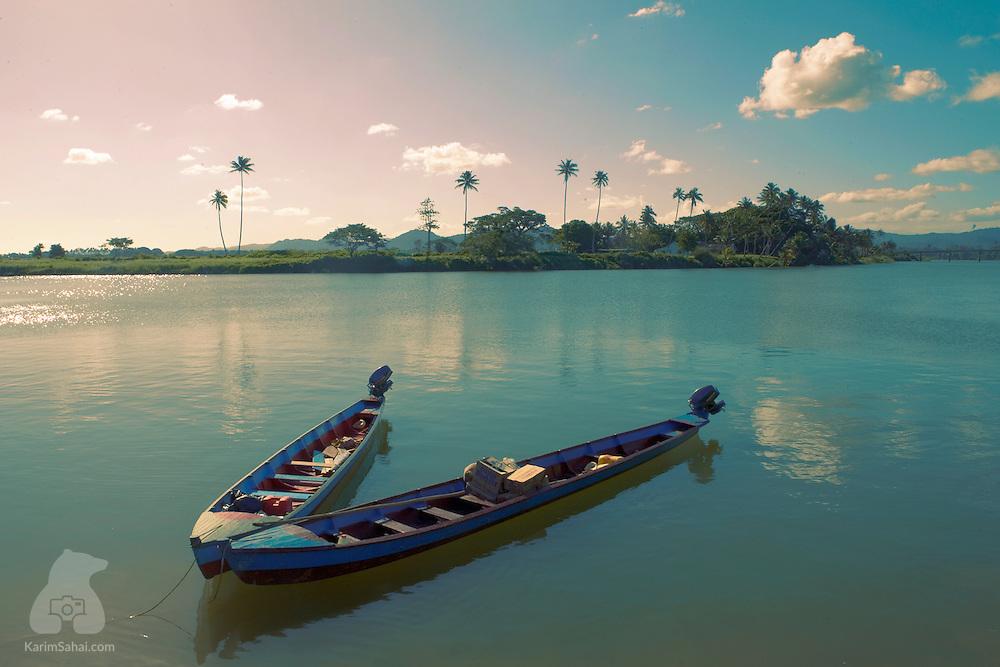 Fishing boats in the estuary near the village of Koromakawa, Viti Levu, Fiji.