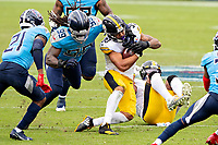 NASHVILLE, TN - OCTOBER 25:  James Conner #30 of the Pittsburgh Steelers is tackled in the second half by Jadeveon Clowney #99 of the Tennessee Titans at Nissan Stadium on October 25, 2020 in Nashville, Tennessee.  The Steelers defeated the Titans 27-24.  (Photo by Wesley Hitt/Getty Images) *** Local Caption *** James Conner; Jadeveon Clowney