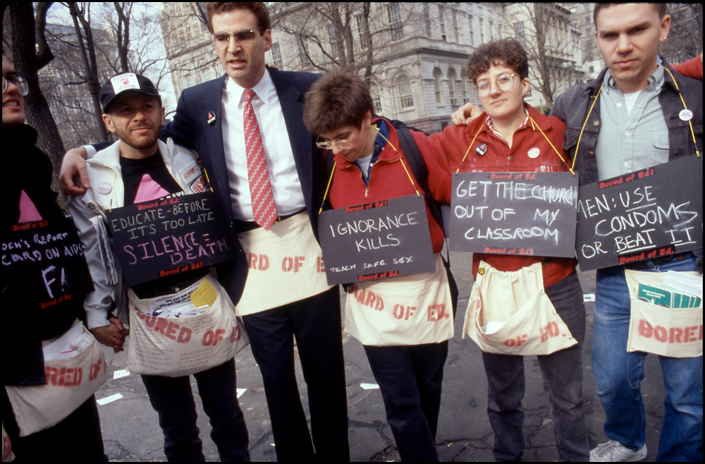 On March 28th, 1989, ACT UP descended on New York City Hall to protest the inadequacy of New York City's AIDS policies under Mayor Ed Koch. <br /> <br /> Members of the Bored of Ed affinity group at Target City Hall 1989: Thomas M. Keane, Brent Nicholson Earle, James Revson, Jamie R Bauer, Donna Minkowitz, Rolf Sjogren