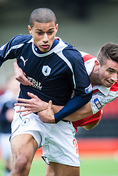 Falkirk's Lyle Taylor held by Airdrie United's Gregor Buchanan..Airdrie United 0 v 1 Falkirk, 30/3/2013..©Michael Schofield..