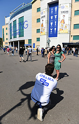 Two fans have their photograph taken ahead of kick off