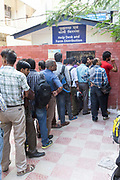 People queueing outside of the Transport Department, New Delhi, India
