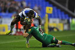 Semesa Rokoduguni of Bath Rugby is tackled by Chris Noakes of London Irish - Photo mandatory by-line: Patrick Khachfe/JMP - Mobile: 07966 386802 22/11/2014 - SPORT - RUGBY UNION - Reading - Madejski Stadium - London Irish v Bath Rugby - Aviva Premiership